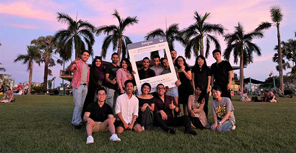 Group shot of international students at sunset