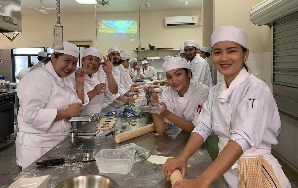 Students working in a kitchen at ICAE