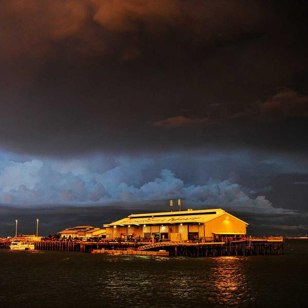 Stokes Hill Wharf jetting at night with storm brewing