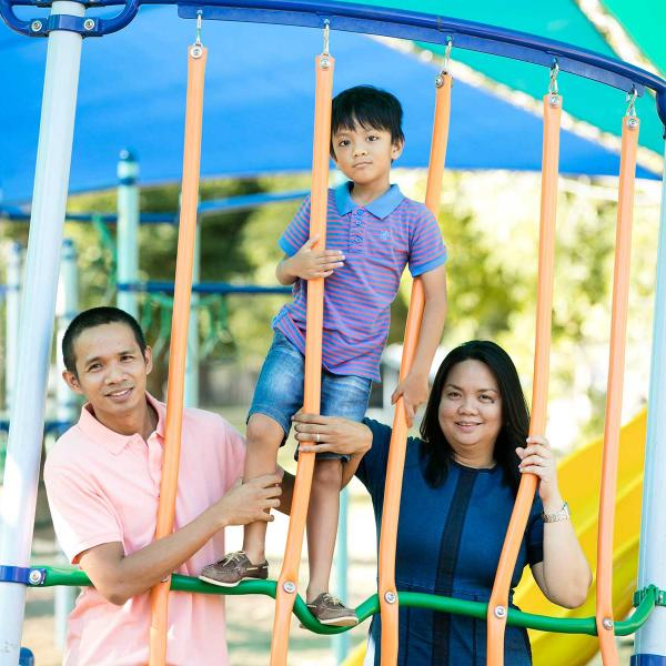 Young migrant family in children's playground