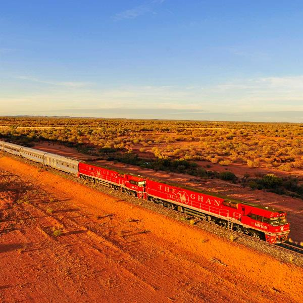 The Ghan train travelling through open countryside