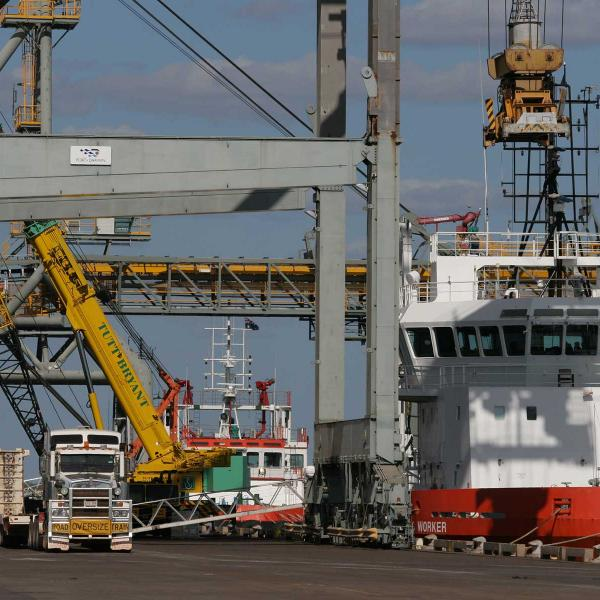 A boat being unloaded by crane in Darwin Port