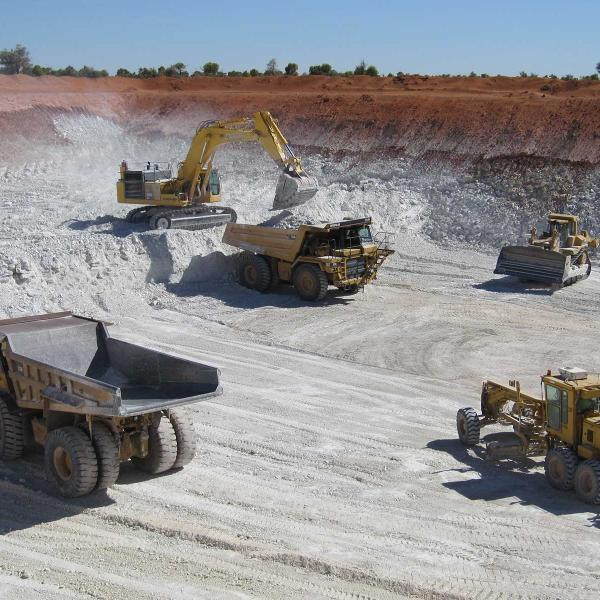 Heavy machinery working in a mine site