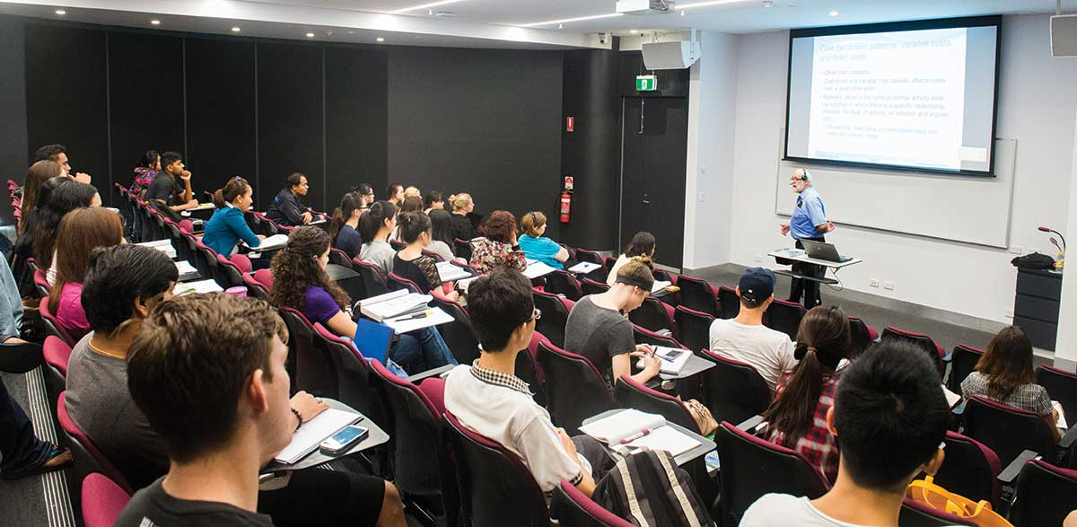 Lecture theatre with lecturer talking to students