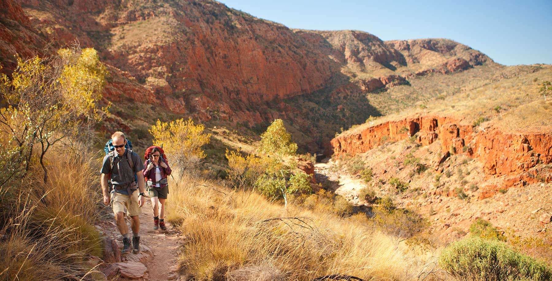 Two people hillwalking in MacDonnell Ranges