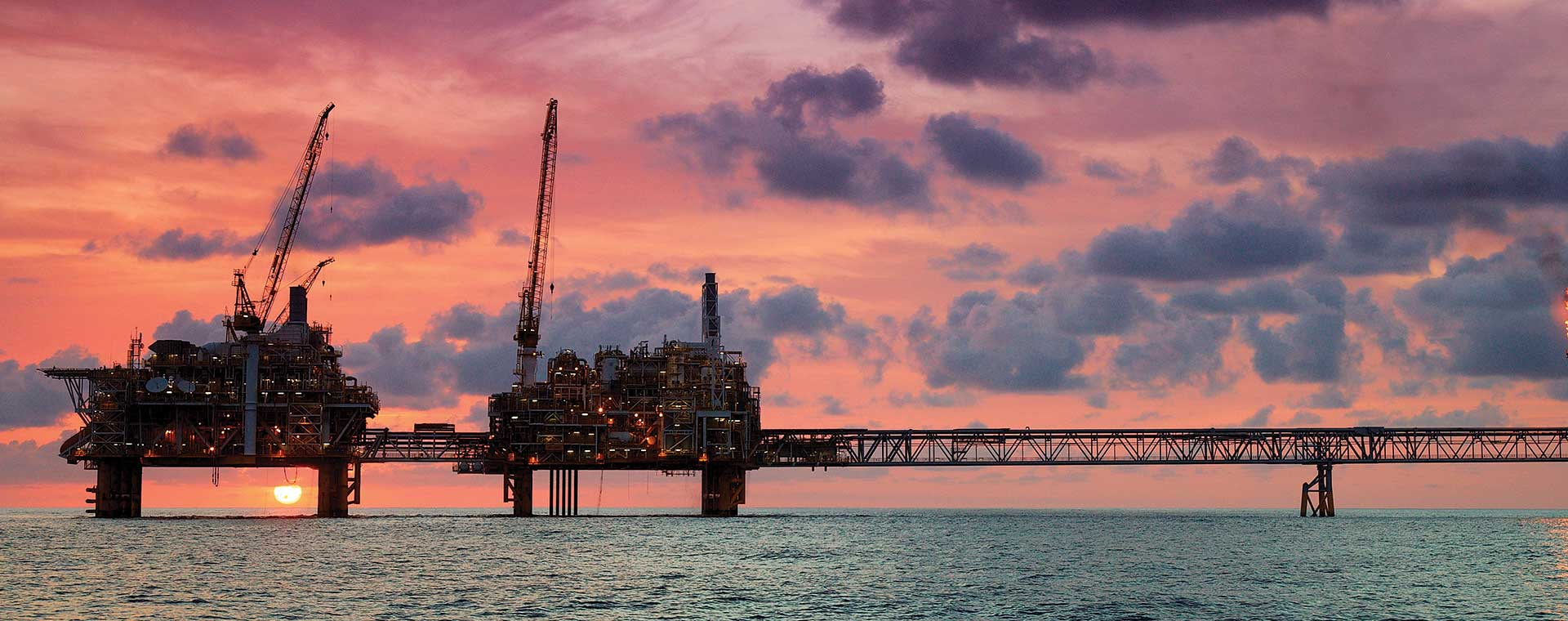 Offshore platforms at sunset
