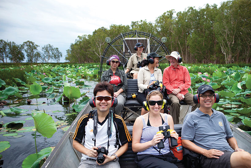 Tourists in an airboat on a floodplain